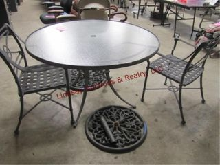 Patio table  2 chairs  2 umbrella stands