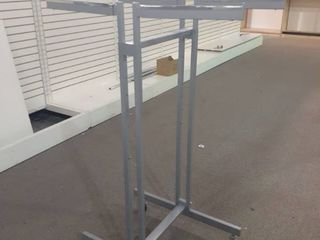 lot of 4 Garment Racks  4 way racks with adjustable height and locking wheels
