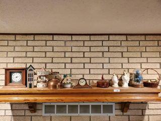 Mantle Clocks  Vases  Contents of Mantle