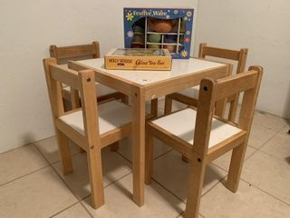 Child s table with 4 chairs  2 tea sets