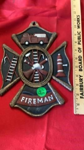 CAST IRON FIREMAN WAll HANGING