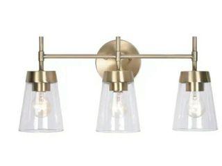Kenroy Home 93983 Delgado 3 light 20 7 8  Wide Bathroom Vanity light   Antique Brass