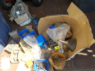 lot of bolts, metal hardware, and m...