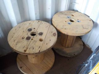 2 round wooden spools 24