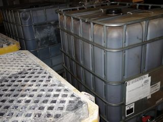 LOT OF 2 330 GALLON CONTAINERS UN 31HA1/Y/08-16 W/ OIL