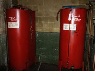 LOT OF 2 LUBRICATION OIL DRUMS W/ EXXON 10W-30 OIL