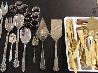 Assortment of Silverware Extra Pieces  Napkin