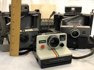3 Polaroid Cameras and Flash