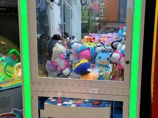 Prize Cube Crane Machine features a familiar ...