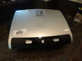 large George Foreman grilling machine