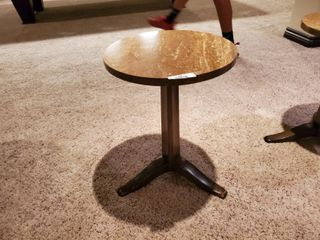 Small round solid surface top pedestal table