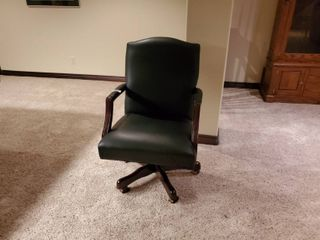High end leather office chair on wheels