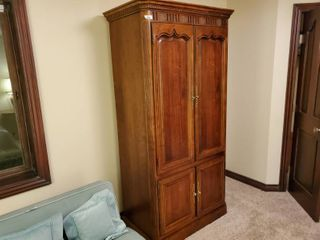 Wood armoire cabinet