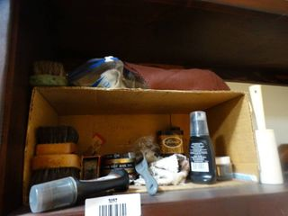 lot of various shoe polish and plastic shoe boxes