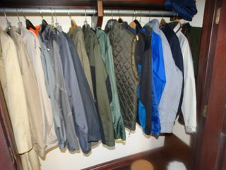 lot of various jackets  coats in front closet