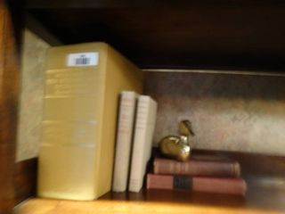 Vintage hard cover books   brass duck