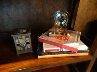 Hard cover books  nice clock  candle holder