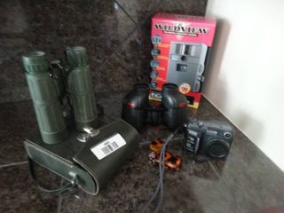 2 pairs of binoculars  wildview digital game camera  Nikon digital camera