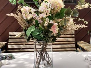 glass flower vase with faux flowers