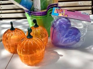 4 green and purple small tubs  3 plastic pumpkin containers  1 purple heart box  2 travel size tissue packs