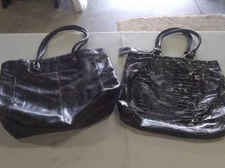 2 large black handbags