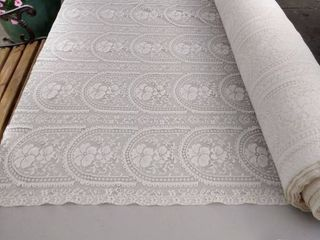roll of decorator fabric  lace