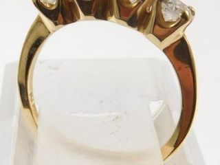 Lot #10: 14k yellow gold ladies 4 stone band