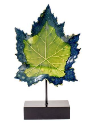 Privilege 24 in ceramic leaf on wood stand