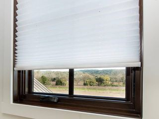 Easy lift Trim at Home Cordless Pleated light Filtering Fabric Shade White  36 in x 64 in   Fits windows 19  36