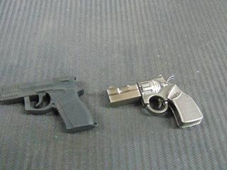 Pair of Gun thumb drives