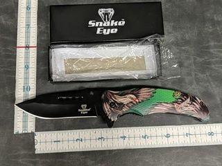 Snake eye pocket knife