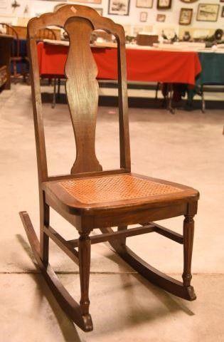 Lot #2904 - Antique cane bottom rocking chair