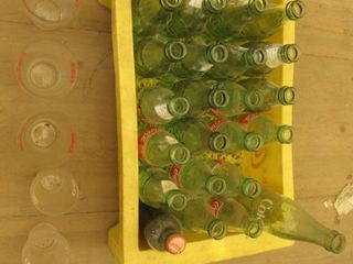 yellow plastic coke case with coke bottles and coke glasses