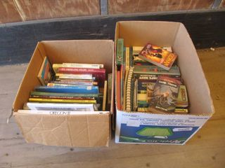 2 boxes with Tom Clancy and Dan Brown books
