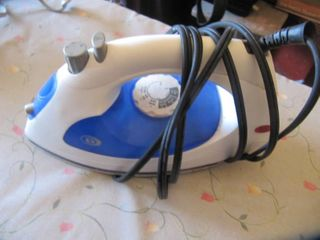 2 irons with ironing board