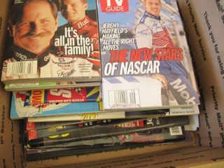 2 boxes of collectible Nascar cards  books placemats and misc