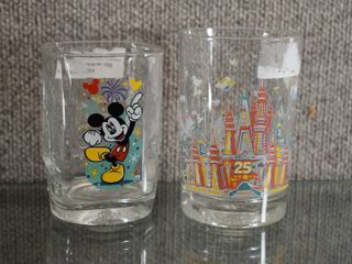 lot of 2 Walt Disney World Glasses Donald Duck   Mickey   25th Anniversary and 2000   4 1 2    5