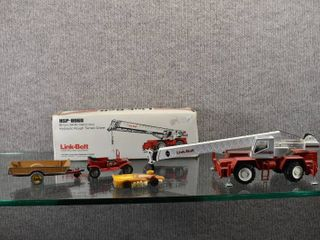 lot of 4 Vintage Die Cast Collectibles   Includes a NZG Modelle link Belt Rough Terrain Crane  with box  lesney Ford Model T  missing Front Seat  Dinky Toys Halesowen Farm Trailer