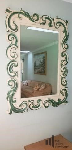 Resin Framed Mirror with Green Accent Scrolls