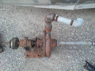 Belt driven pump, steam punk, wood pulley wheels.