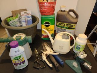 Gardening Supplies  Plant food  tools  rain gauges  and other items