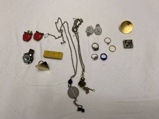 ladies jewelry  to sweater holders  eight rings  four button covers and two scarf pins