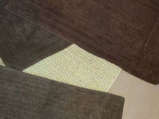 4 Pcs  Bathroom Rugs  And a Carpet Non Skid Pad  Brown in color