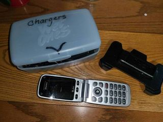 Random Cell Phone  And Accessories Otterbox Chargers for Motorola and Nokia and an AT T Flip phone