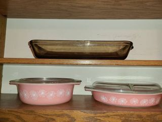 Pyrex dishes  2 Pink with lids  Both are 1 1 2 qts  Brown is 3qts