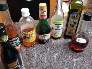Assorted vinegars  cider and olive oil