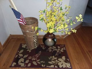 Entry Rug with Faux Flowers in Vase and Umbrella Basket