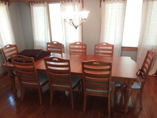 Broyhill Wood Dining Table 30 x 108 x 44 in Measurements include 2 leaves 18 in Wide Each and 6 Dining Chairs and 2 Captains Dining Chairs with Table Cover