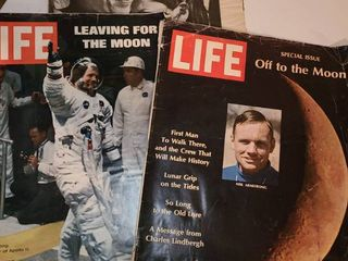 3 life Magazines  2 are about the moon and the other is about Prince Charles
