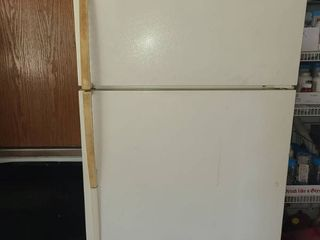 MAYTAG Refrigerator  This one has been in a garage it Works  It is 67  tall x 33  wide x 34  deep